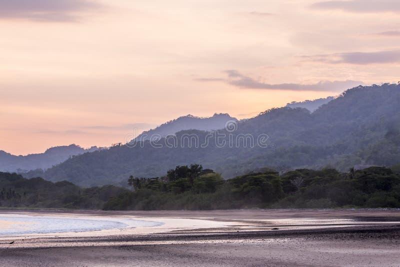 Waves and sunset, playa tambor Costa Rica royalty free stock photography