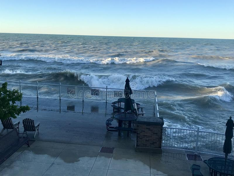 Lake Michigan gets angry. Waves swell on the Illinois side of Lake Michigan, crashing onto the beach and over railings royalty free stock photography