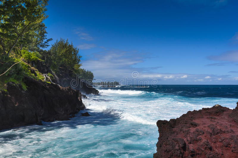 Waves and volcanic rocks in the south coast of Reunion Island royalty free stock photos