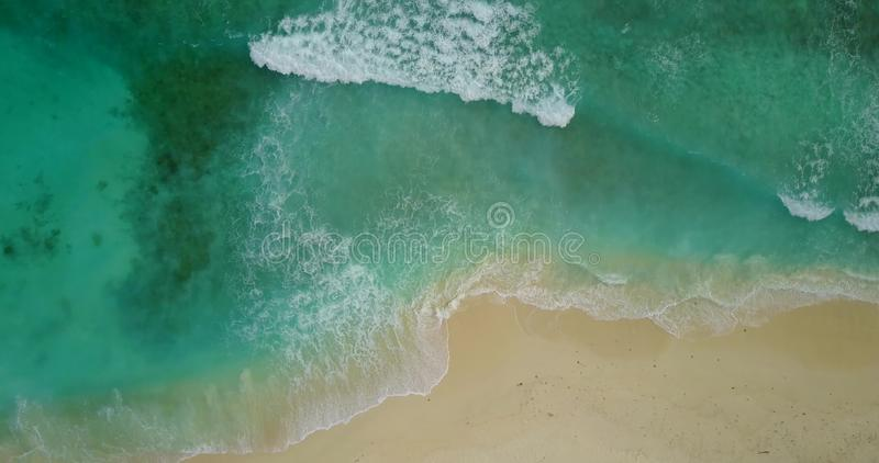 V11161 waves water texture breaking and crashing with drone aerial flying view of aqua blue and green clear sea ocean. Waves water texture breaking and crashing royalty free stock images
