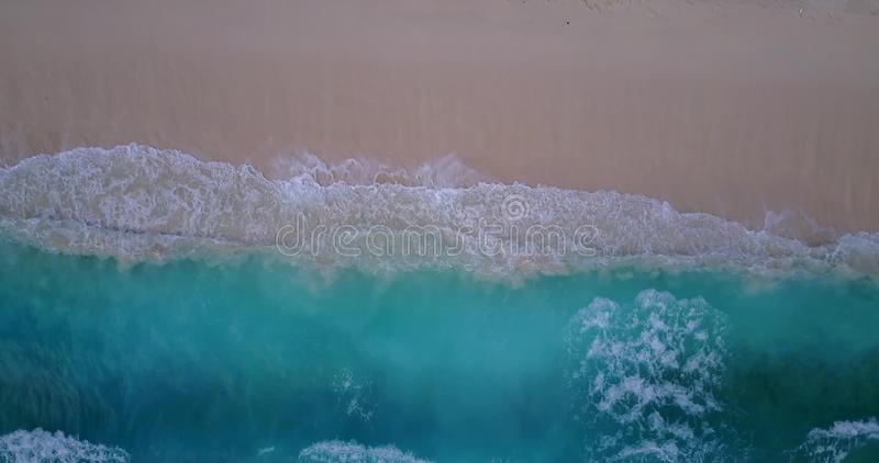 V10031 waves water texture breaking and crashing with drone aerial flying view of aqua blue and green clear sea ocean royalty free stock photos