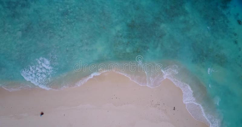 V14356 waves water texture breaking and crashing with drone aerial flying view of aqua blue and green clear sea ocean royalty free stock photography
