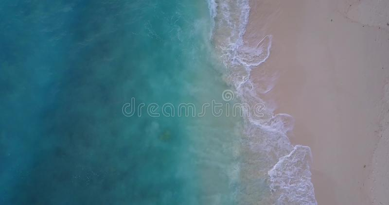 V10007 waves water texture breaking and crashing with drone aerial flying view of aqua blue and green clear sea ocean. Waves water texture breaking and crashing stock photography