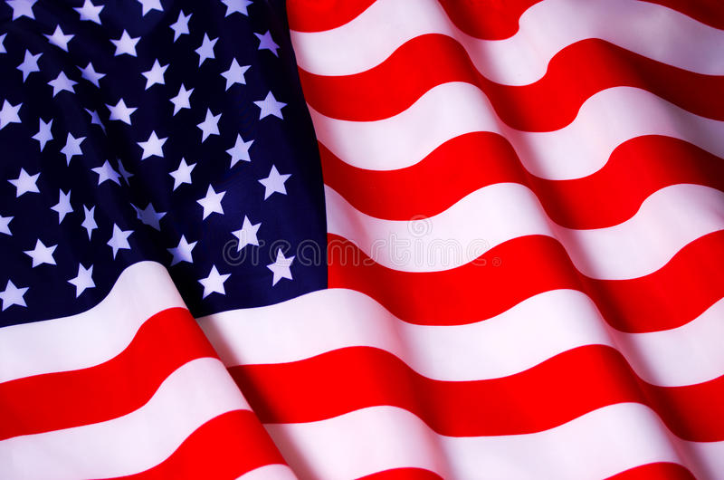 Waving American flag. Beautifully waving star and striped American flag royalty free stock photo