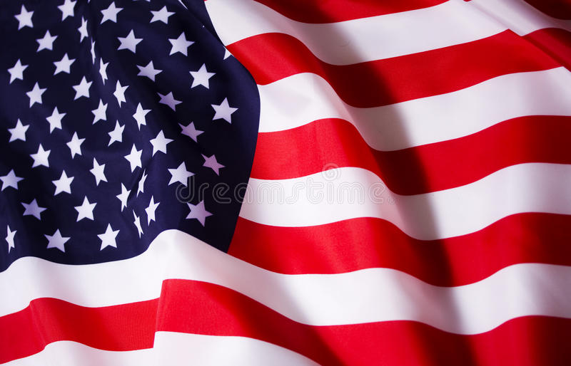 Waving American flag. Beautifully waving star and striped American flag stock photo