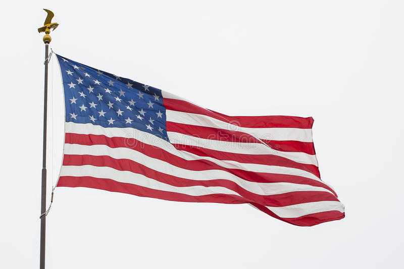Waving American Flag And Eagle Pole, Isolated. Waving American, USA flag and a pole with an eagle topper - ornament, isolated on white stock photos