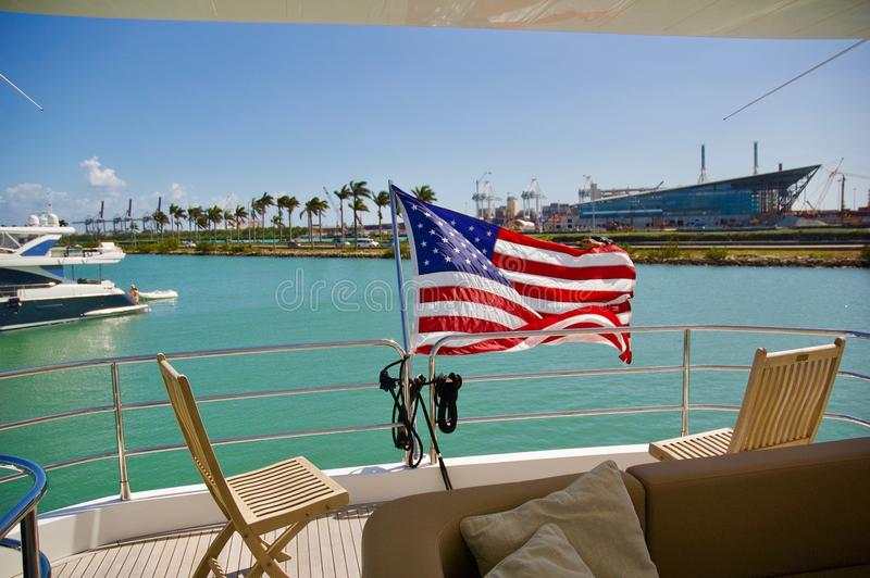 Waving American Flag on Miami, Yacht. A beautiful American flag waving in the wind on a luxury Miami yacht stock photography