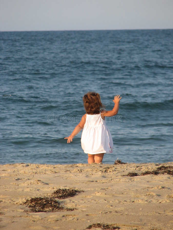 Waving on the beach royalty free stock images