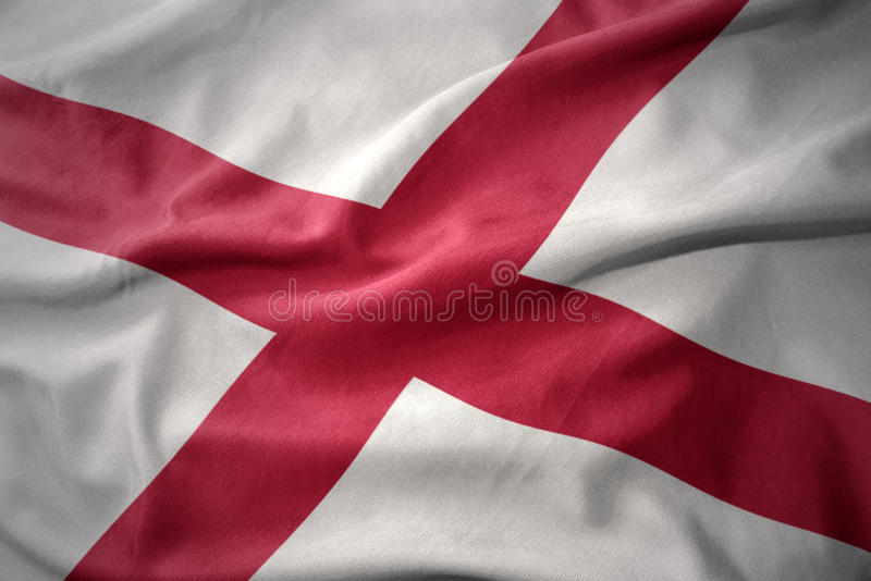 Waving colorful flag of alabama state. royalty free stock images