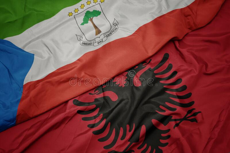 Waving colorful flag of albania and national flag of equatorial guinea. Macro stock photography