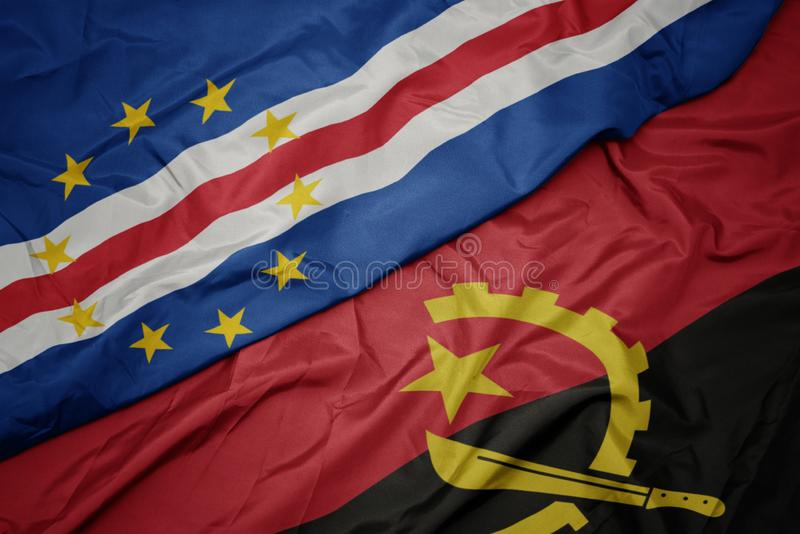 Waving colorful flag of angola and national flag of cape verde. Macro royalty free stock photo