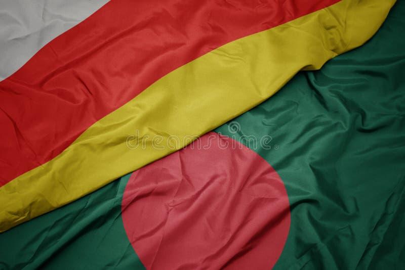 Waving colorful flag of bangladesh and national flag of south ossetia. Macro royalty free stock photos