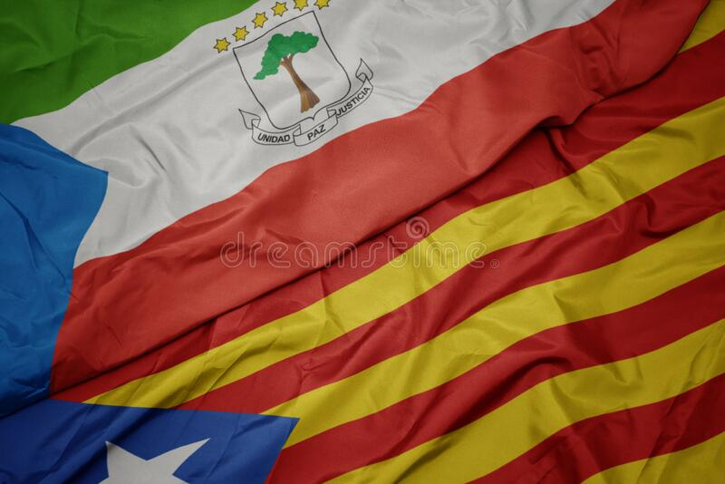Waving colorful flag of catalonia and national flag of equatorial guinea. Macro royalty free stock images