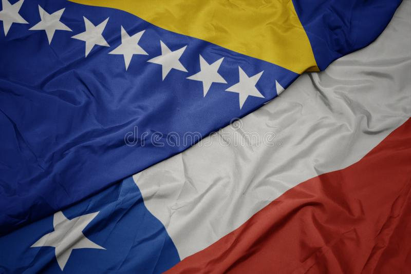 Waving colorful flag of chile and national flag of bosnia and herzegovina. Macro royalty free stock image