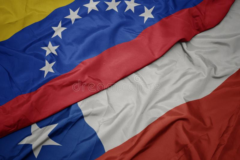 Waving colorful flag of chile and national flag of venezuela. Macro royalty free stock photos