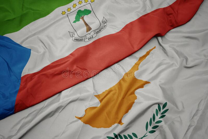 Waving colorful flag of cyprus and national flag of equatorial guinea. Macro stock photos