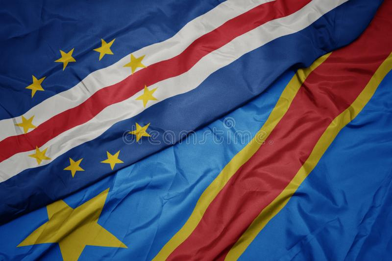 Waving colorful flag of democratic republic of the congo and national flag of cape verde. Macro royalty free stock image