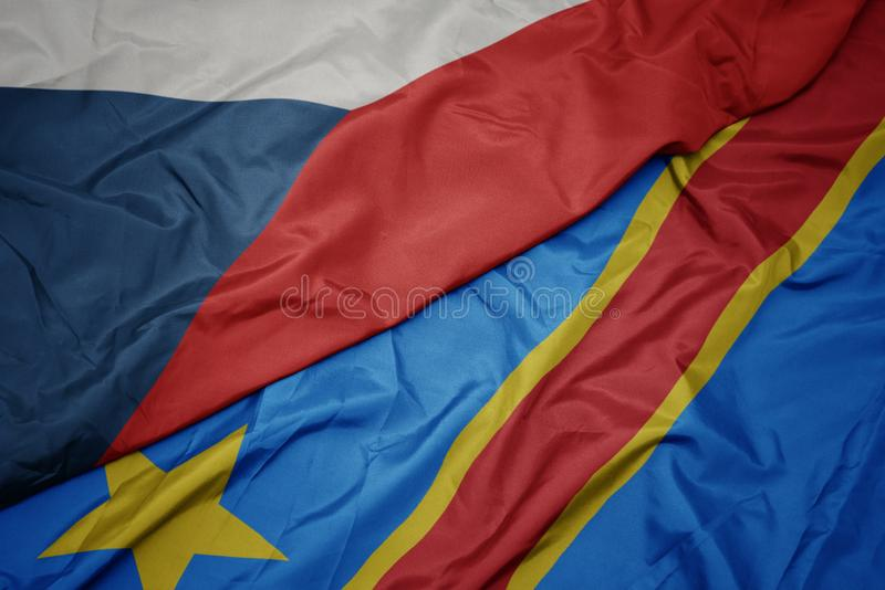 Waving colorful flag of democratic republic of the congo and national flag of czech republic. Macro royalty free stock photography