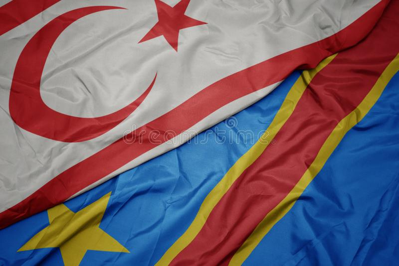 Waving colorful flag of democratic republic of the congo and national flag of northern cyprus. Macro stock image