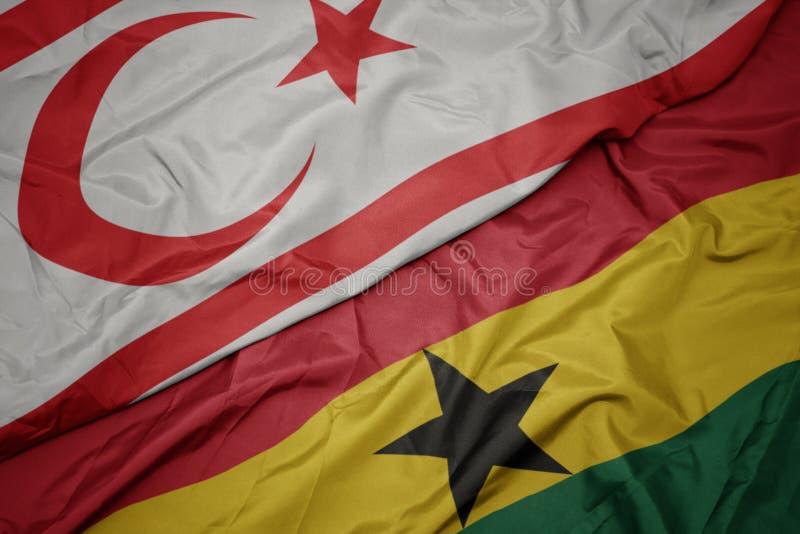 Waving colorful flag of ghana and national flag of northern cyprus. Macro stock photos