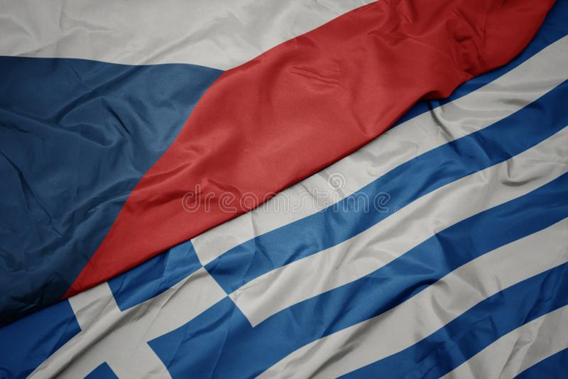 Waving colorful flag of greece and national flag of czech republic. Macro stock photos