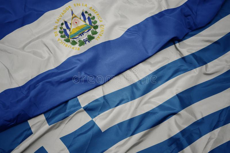 Waving colorful flag of greece and national flag of el salvador. Macro royalty free stock photo