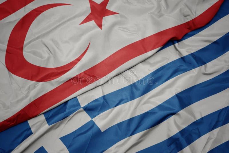 Waving colorful flag of greece and national flag of northern cyprus. Macro stock photo