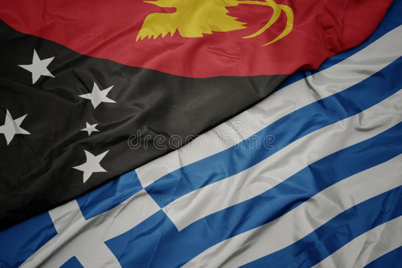 Waving colorful flag of greece and national flag of Papua New Guinea. Macro royalty free stock photos