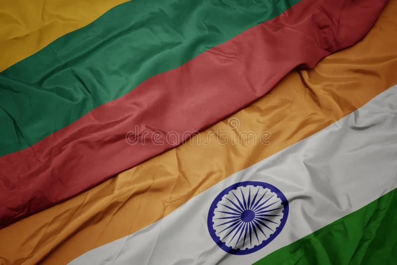 Waving colorful flag of india and national flag of lithuania. Macro royalty free stock photography
