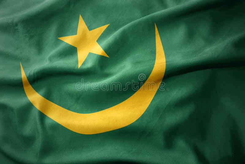 Waving colorful flag of mauritania. Waving colorful national flag of mauritania stock images