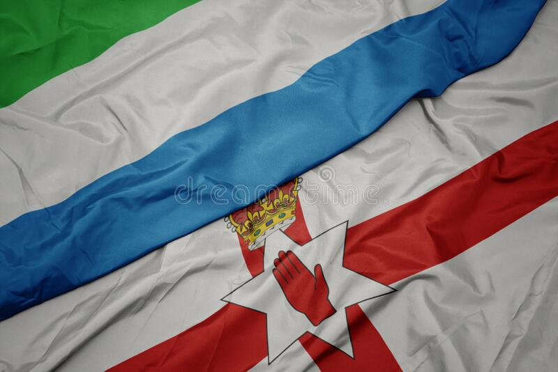 waving colorful flag of northern ireland and national flag of sierra leone royalty free stock images