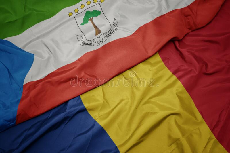 Waving colorful flag of romania and national flag of equatorial guinea. Macro royalty free stock photo