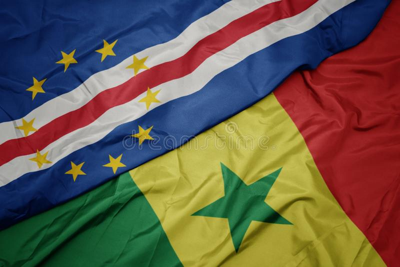 Waving colorful flag of senegal and national flag of cape verde. Macro royalty free stock images