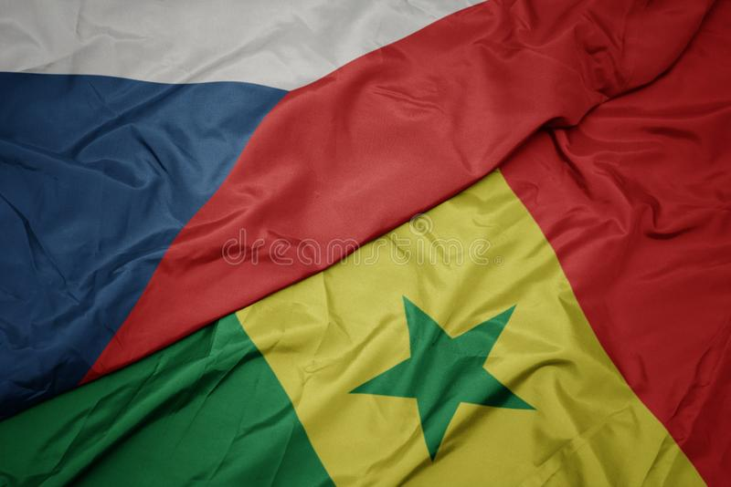 Waving colorful flag of senegal and national flag of czech republic. Macro royalty free stock photography