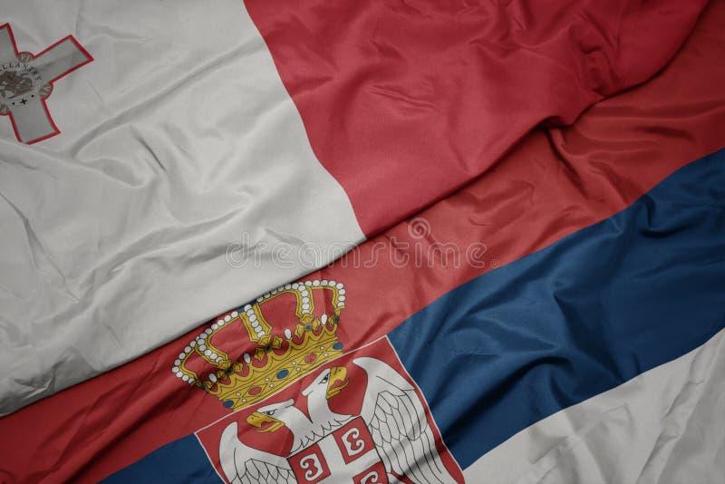 Waving colorful flag of serbia and national flag of malta. Macro stock illustration