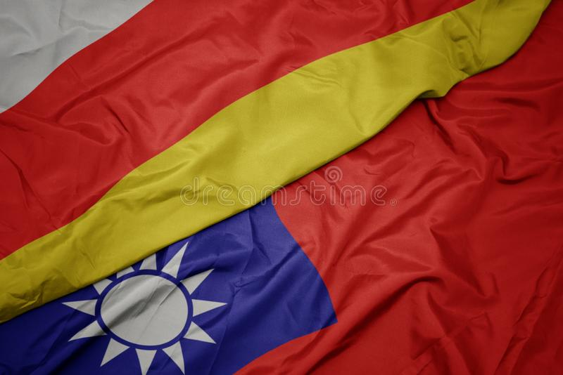 Waving colorful flag of taiwan and national flag of south ossetia. Macro royalty free stock photography