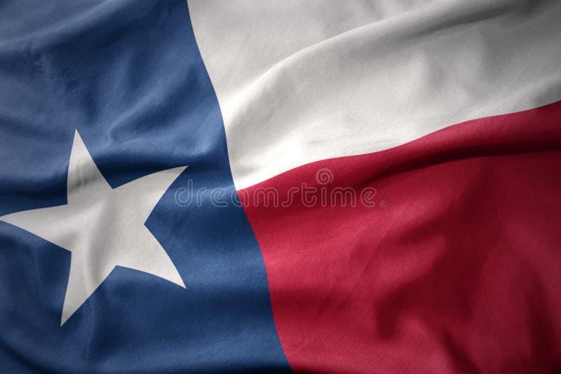 Waving colorful flag of texas state. Waving colorful national flag of texas state royalty free stock image