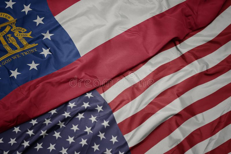 waving colorful flag of united states of america and flag of georgia state royalty free stock image