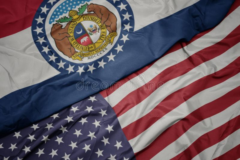 Waving colorful flag of united states of america and flag of missouri state. Macro royalty free stock images