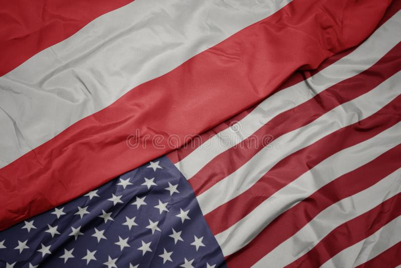 Waving colorful flag of united states of america and national flag of austria. Macro royalty free stock image
