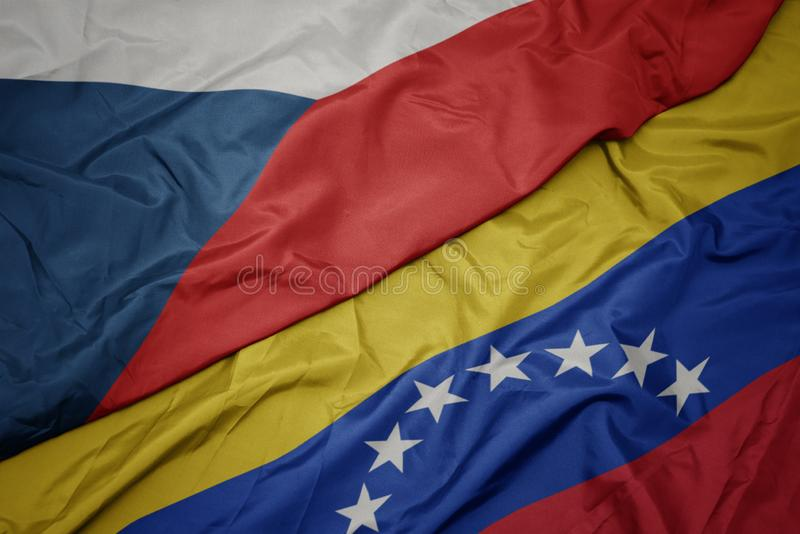 Waving colorful flag of venezuela and national flag of czech republic. Macro royalty free stock images