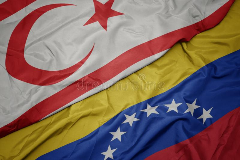 Waving colorful flag of venezuela and national flag of northern cyprus. Macro royalty free stock images