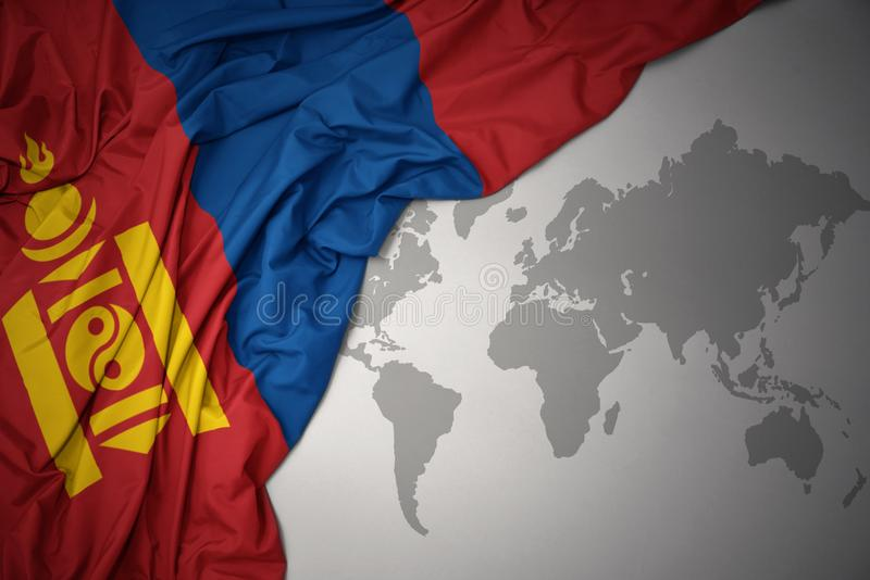 Waving colorful national flag of mongolia stock photo image of waving colorful national flag of mongolia on a gray world map background gumiabroncs Image collections