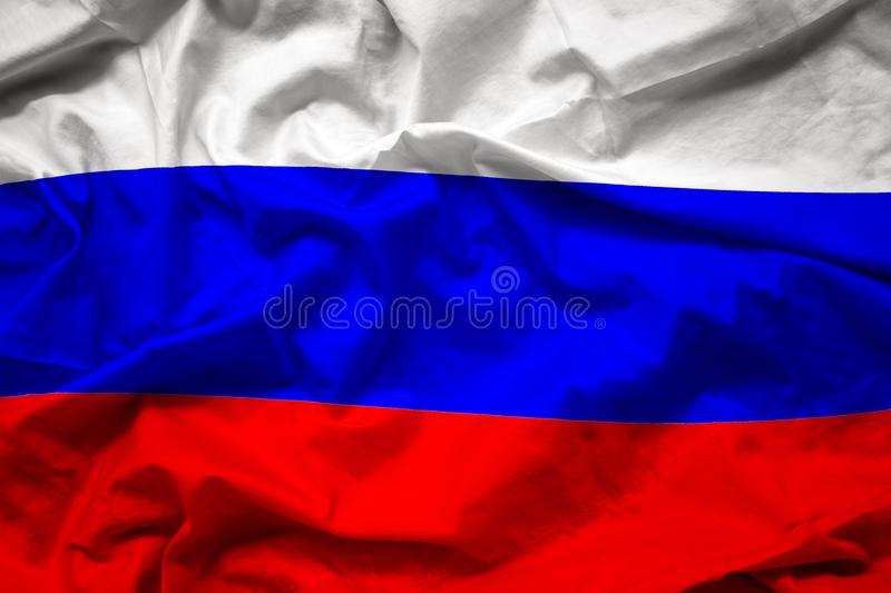 Waving colorful national flag of russia , russian federation. On silk texture royalty free stock photo