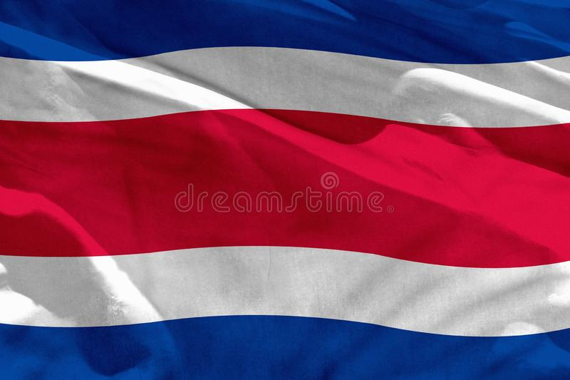 Waving Costa Rica flag for using as texture or background, the flag is fluttering on the wind. Fluttering Costa Rica flag for using as texture or background, the stock image