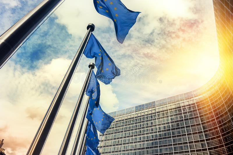 Waving EU flags in front of European Commission in Brussels royalty free stock photos