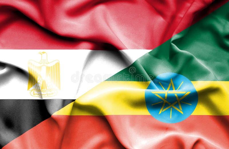 Waving flag of Ethiopia and Egypt royalty free stock photos