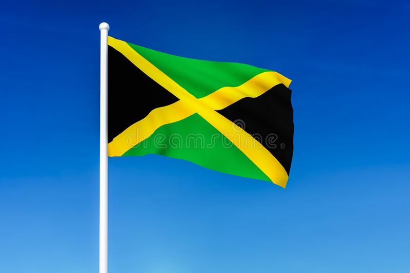 Waving flag of Jamaica on the blue sky background. 3D rendered vector illustration