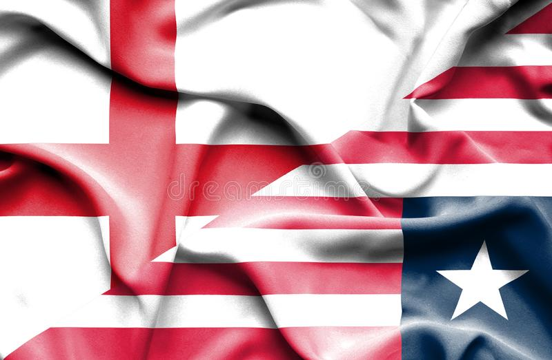 Waving flag of Liberia and England stock images