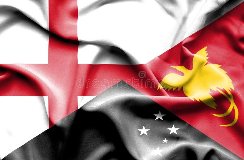Waving flag of Papua New Guinea and England royalty free stock images